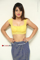 Cute Telugu Actress Shunaya Solanki High Definition Spicy Pos in Yellow Top and Skirt  0062.JPG