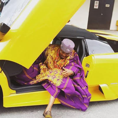 """Oba Yahoo Yahoo"" Oluwo of Iwo Land poses with Lamborghini sports car"