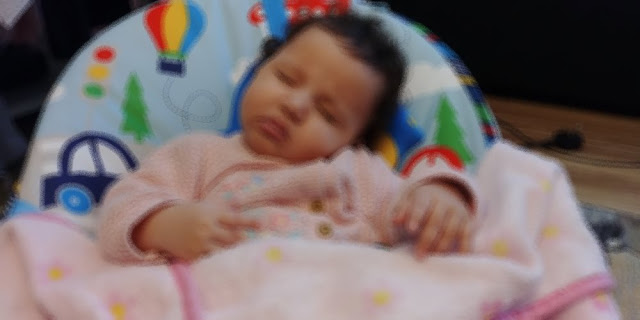 blurred image of a sleeping baby