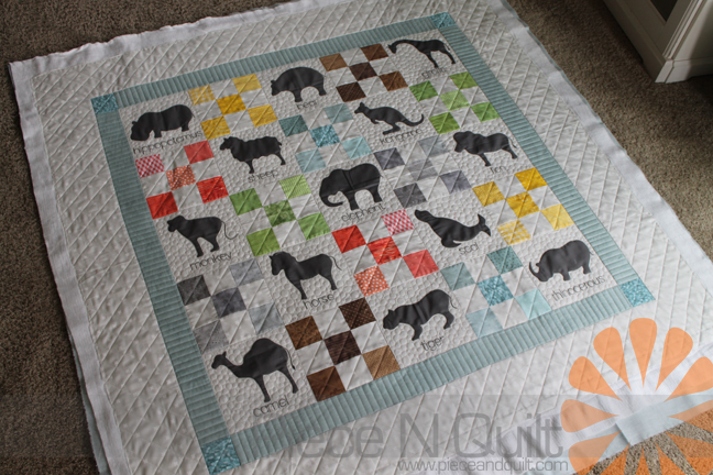Piece n quilt animal crackers quilt custom machine quilting by in each of the 9 patch blocks i machine quilted cross hatching so to tie the border to those blocks i machine quilted cross hatching in the outer border ccuart Image collections