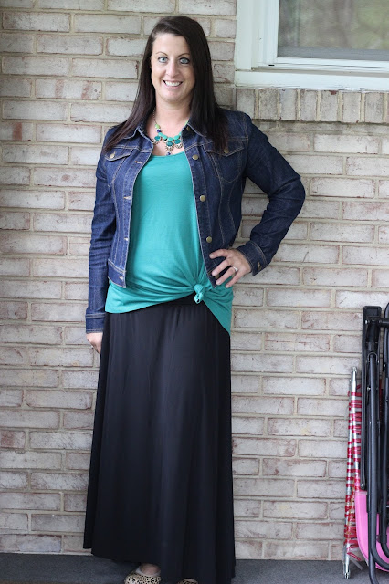 Denim jacket with black maxi skirt