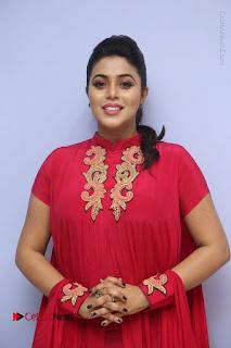 Actress Poorna Latest Stills in Red Dress at Rakshasi First Look Launch  0053.JPG