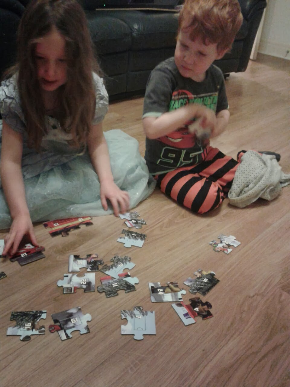 Caitlin and Ieuan assembling the Fireman Sam Advent Puzzle