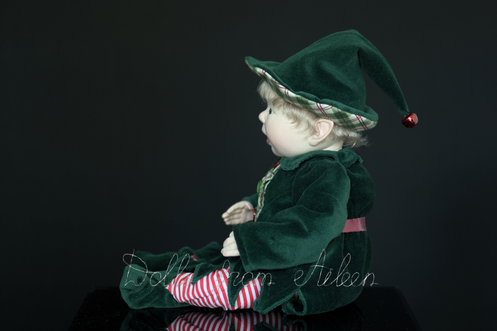 ooak Christmas elf art doll in profile
