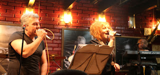The two fronting singers and the keyboard player sing together