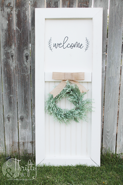 DIY Farmhouse barn door porch decor. Vintage door decor for your porch. Porch decor and decorating ideas.