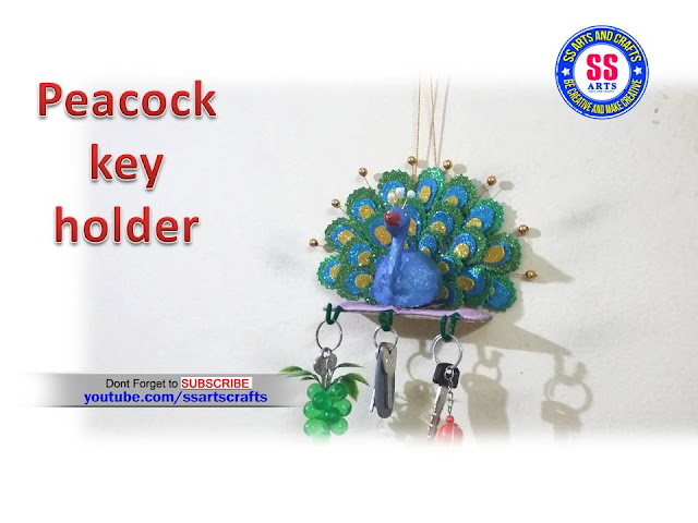 Here is peacock wall art ,how to make peacock key holder using waste materials,card board key holder,how to make peacock wall hanging ideas,how to make peacock key holder at home,how to make peacock using glitter foam sheet,how to make peacock using shilpakar clay,how to make peacock key holder at wall decoration