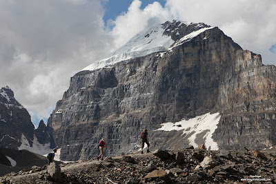 Hikers ascend the Plain of the Six Glaciers trail below Mount Victoria in Banff National Park, Alberta, Canada.