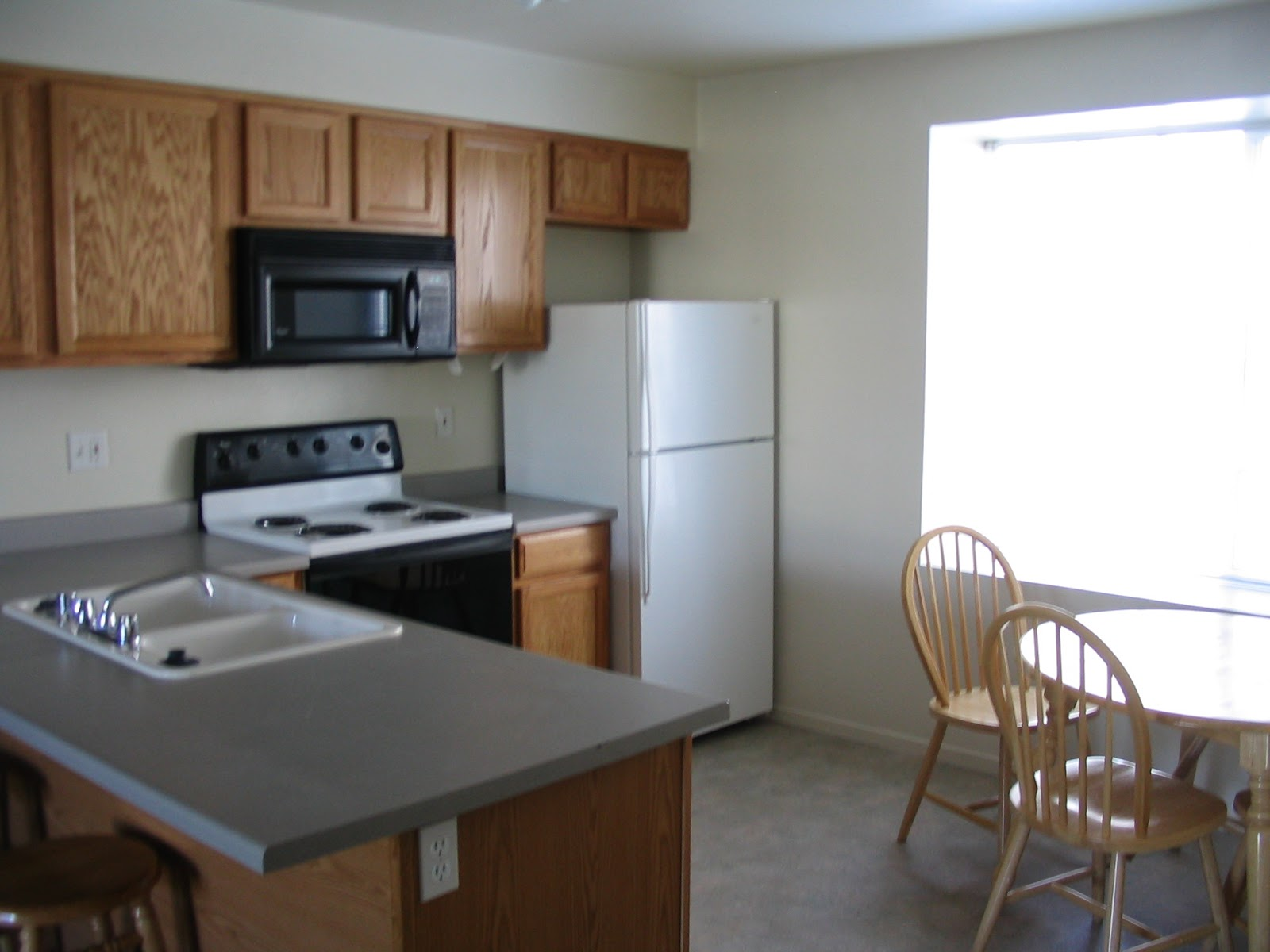 Our Kitchens Include Range And Oven Microwave Dishwasher Refrigerator Pantry Also Have A Table Four Chairs