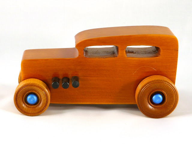 Left Side - Wooden Toy Car - Hot Rod Freaky Ford - 32 Sedan - Pine - Amber Shellac - Black Pipes - Metallic Blue Hubs