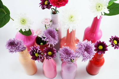 http://www.thesitsgirls.com/diy/painted-glass-bottle-vases/