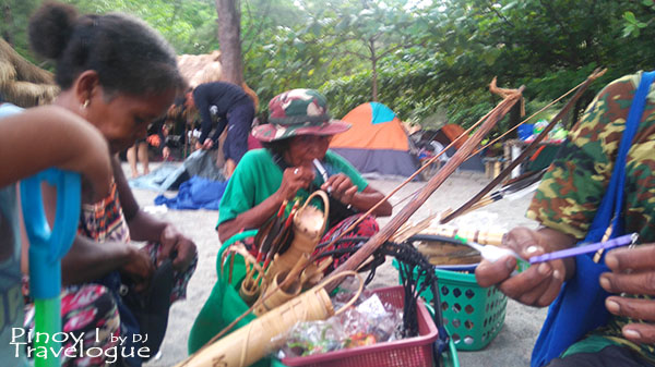 Aetas selling their crafts in Nagsasa Cove