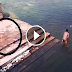 WATCH: Creepy Footage of a Ghost Jumping in a Pond?!