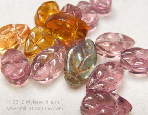 Collection of pink, amber and blue Czech glass leaf beads