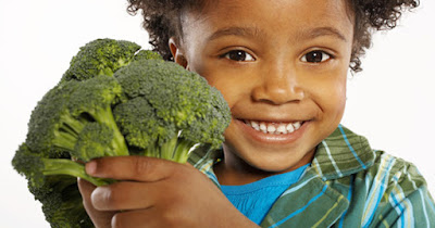 African American girl with broccoli