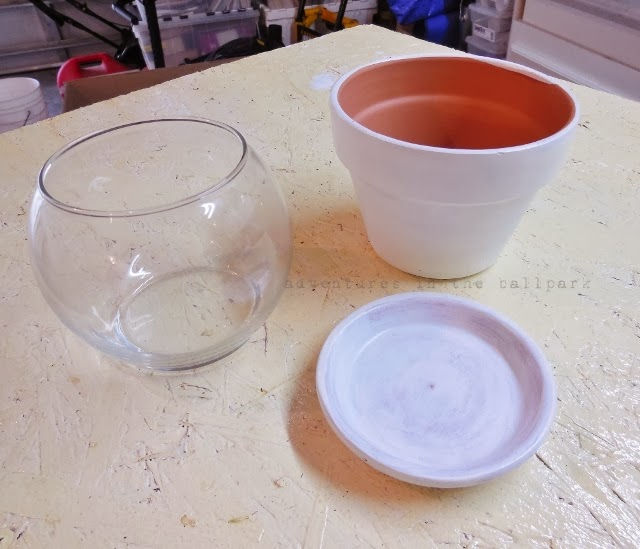 terra cotta pots and glass bowl