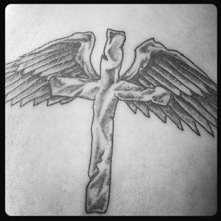 tattoo, cross and wings,