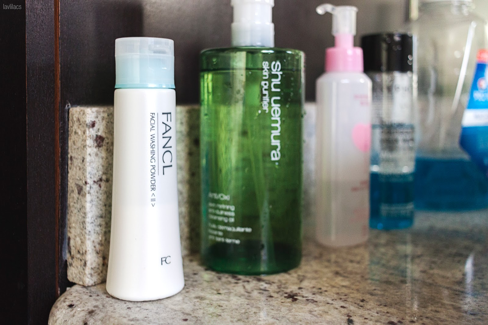 Daily cleansing skincare products on top bathroom counter