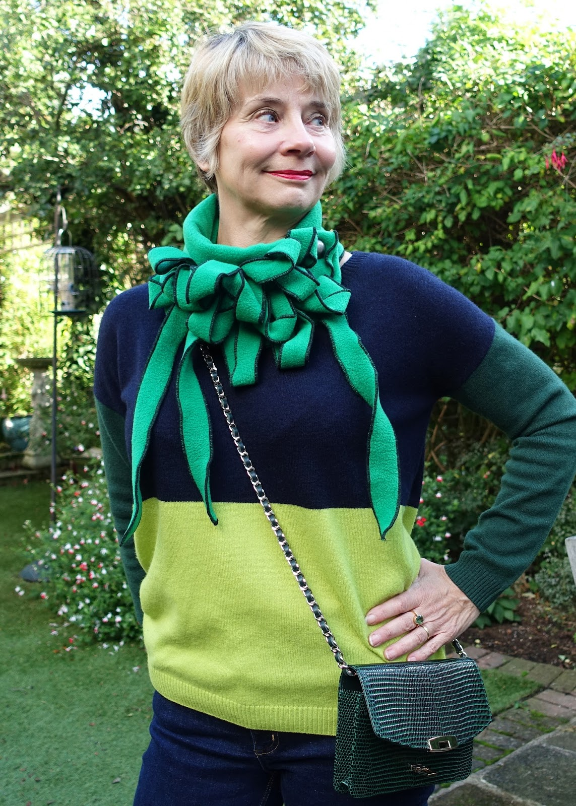 Image showing a striking Rew scarf, the neckwear fastened with one button, in green