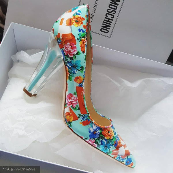 turquoise floral and traffic cone printed Moschino shoe on white background