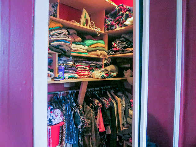 cluttered closet filled with clothes, pre-minimalism