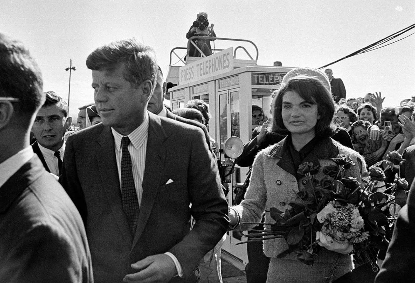 In this November 22, 1963 photo, President Kennedy and his wife, Jacqueline Kennedy, arrive at Love Field airport in Dallas, Texas.