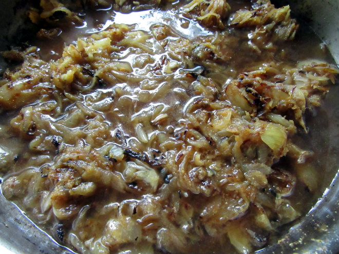 Steak casserole by Laka kuharica: stir in the flour and slowly add the stock.