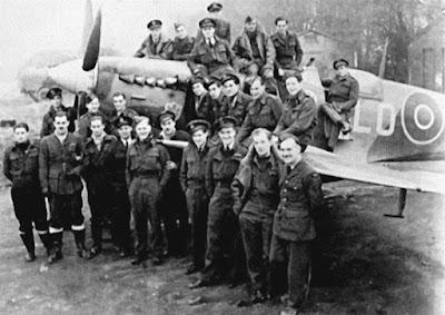 Staff pose with a Spitfire, RAF Detling, 1944