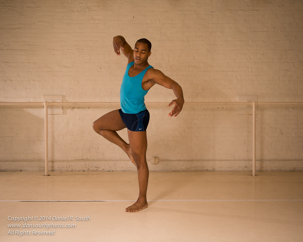 a photo of a modern dancer in his studio