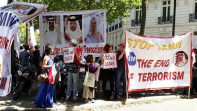 وقفة احتجاجية في باريس ضد زيارة أمير قطر لفرنسا