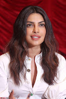 Priyanka Chopra in White Shirt and Colorful Skirt at Baywatch Press Conference  15th May 2017 ~  Exclusive 25.jpg