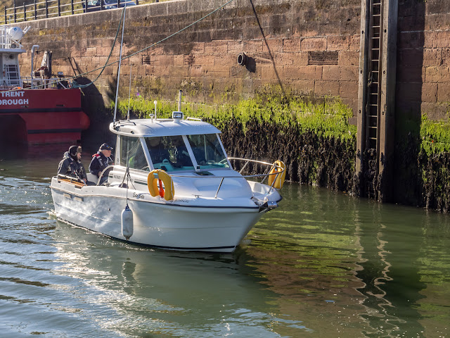 Photo of a group of fishermen setting off from Maryport Marina