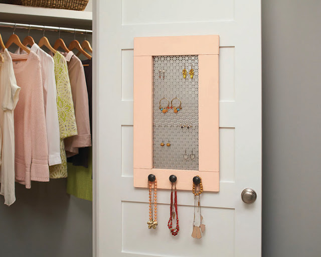 pink jewelry organizer hung on the closet door