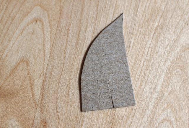 Cut out shark fin shape to make shark binoculars