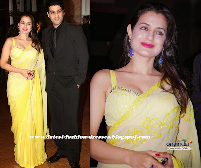 Bollywood actress in yellow colour saree