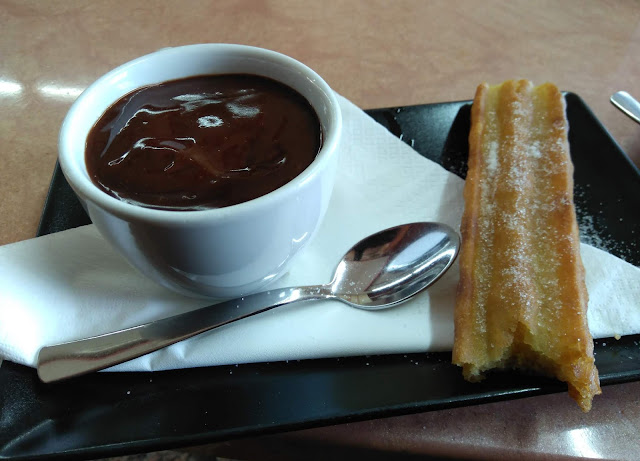 Churro with chocolate pudding.