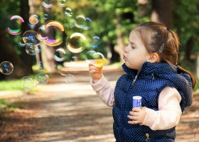 A child blowing bubbles.