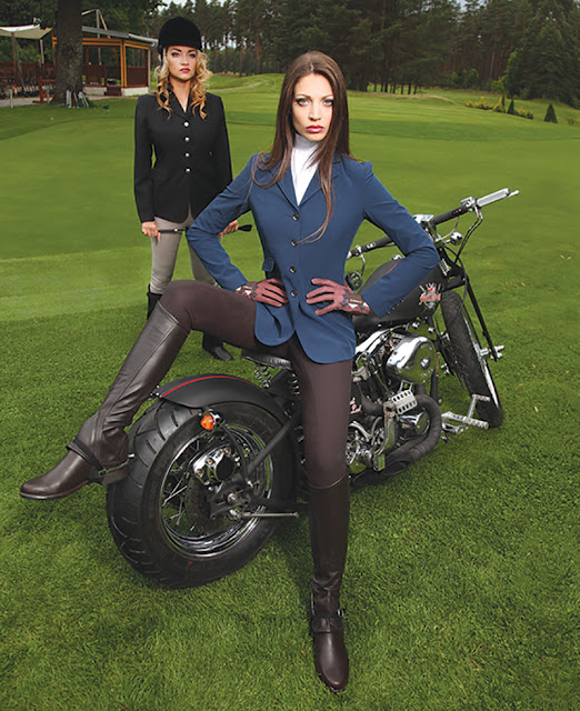 Girls in equestrian wear pose with a custom Harley Davidson