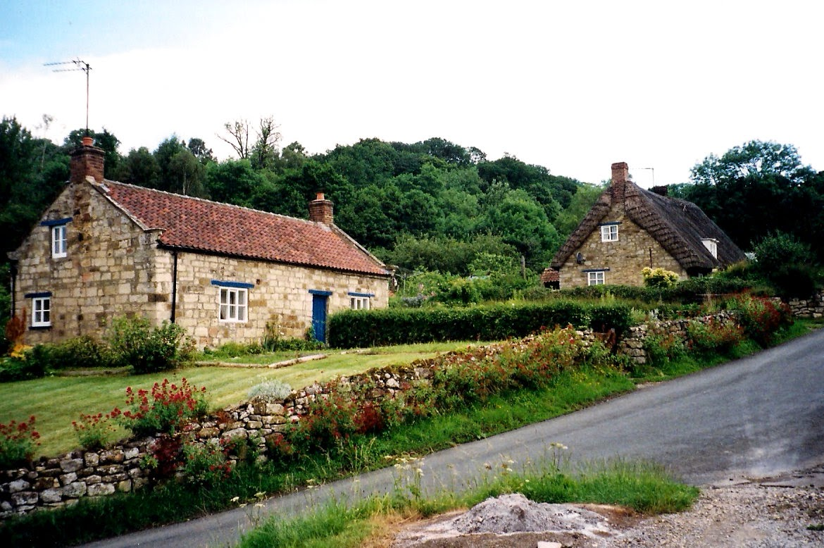 stone cottages surrounded by a low stone wall