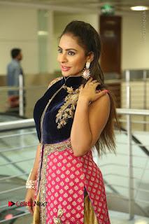 Telugu Actress Sri Reddy Mallidi Stills in White Beautiful Dress at Marriage Needs Bridal Fashion Week 2017 Logo Launch  0073.JPG