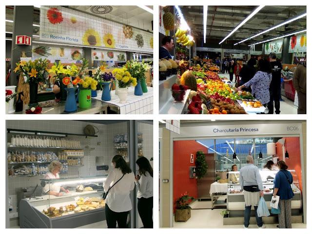 várias bancas de produtos e pessoas a comprar no Mercado Temporário do Bolhão