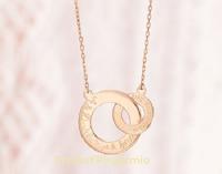 Logo Merci Maman : vinci gratis la romantica collana intrecciata