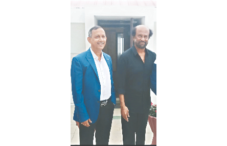 Minister Gautam Deb with superstar Rajinikanth