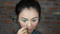 Sparkling Green New Year's Eve make up -Use cotton bud to clean the inner corner.