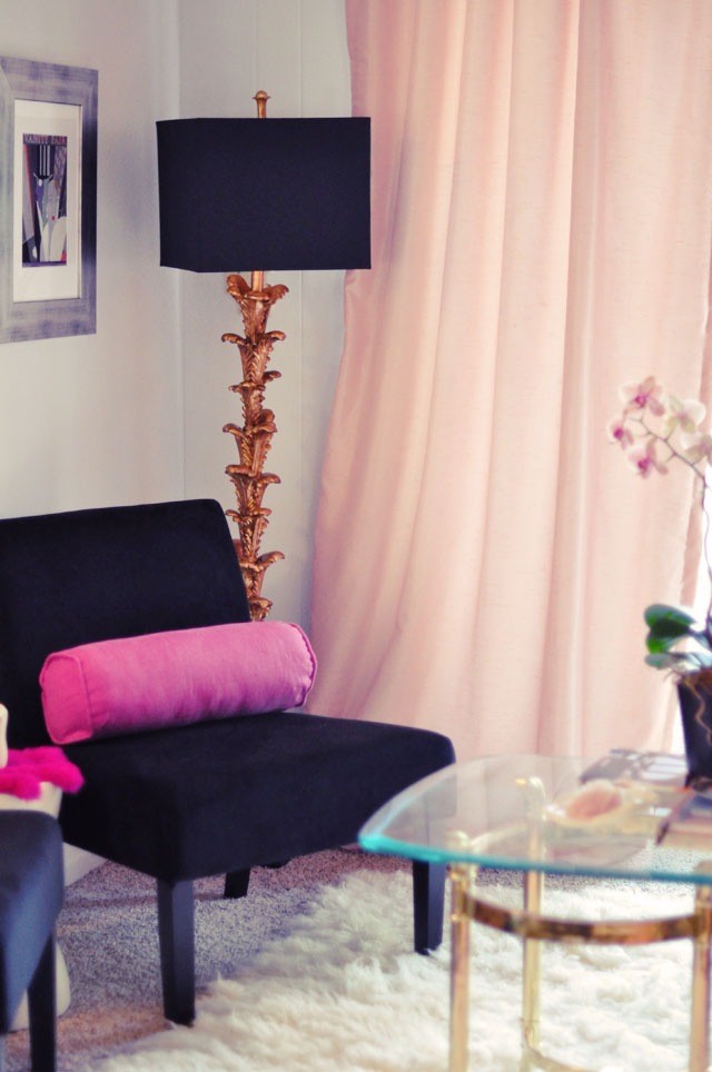 black chairs, gold leaf lamp