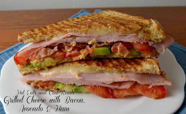 One of the best grilled cheese sandwiches ever! Great for lunch with a bowl of soup! Bacon, Ham, Avocado and Tomato Grilled Cheese Recipe from Hot Eats and Cool Reads