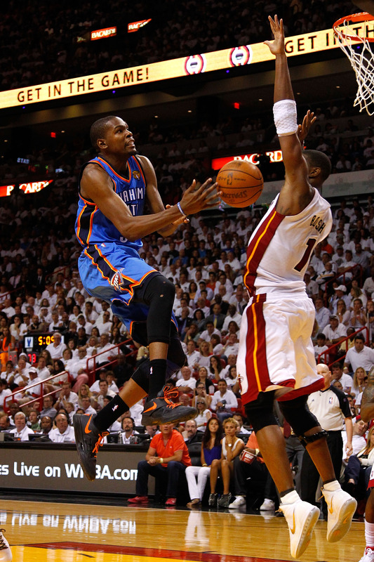 Kevin Durant and Chris Bosh in the Nike Zoom KD IV and the Nike Air Max  Hyperdunk 2011 b43612379