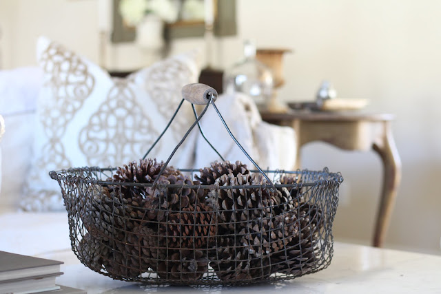 living-room-design-winter-decor-basket-vintage-pinecones