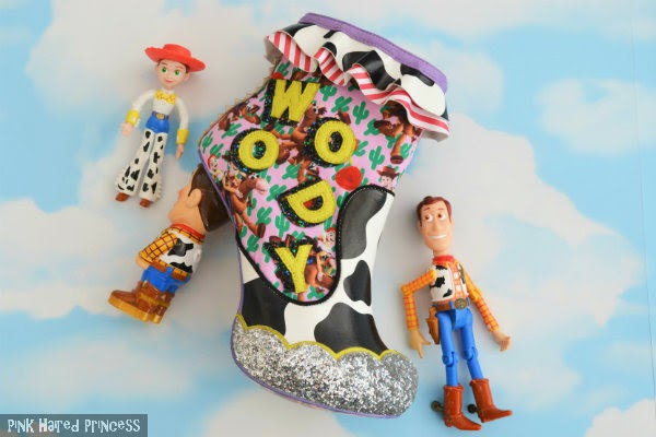 woody toy story ankle boot lying against cloud wallpaper with jessie and woody toy figures