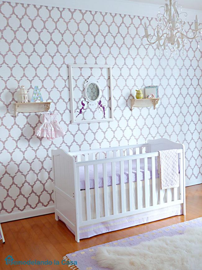 crib and cute decor in girl nursery